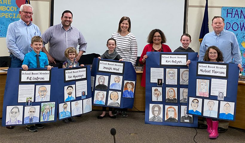 2020 School Board members with students presenting posters